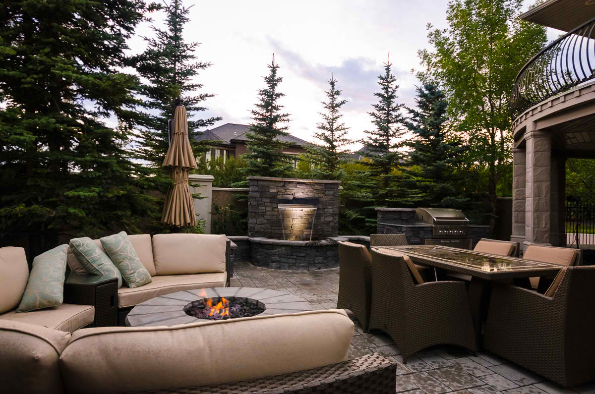 Landscape designs include water features, fire pit and outdoor cooking areas