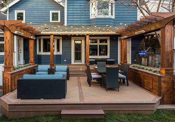 Arbour roof structure over deck and outdoor kitchen