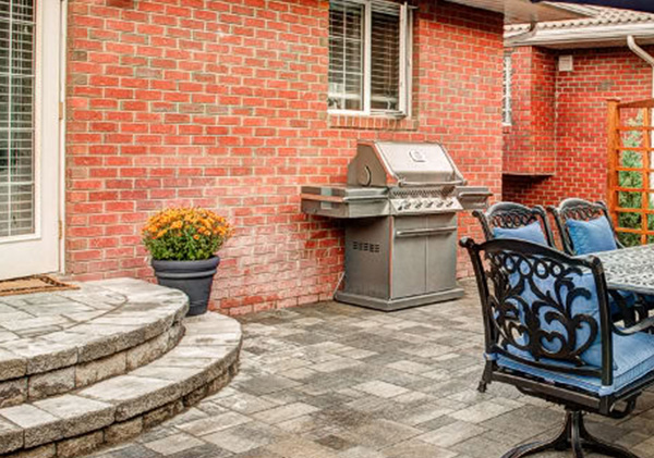 Stone block round steps design into the patio area in the yard
