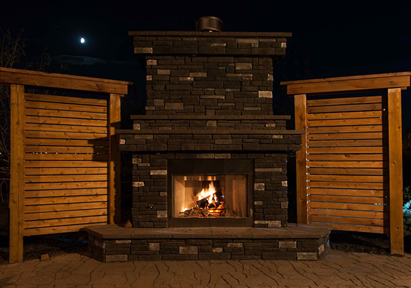 Outdoor fireplace feature in the backyard.