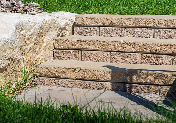Stone block steps designed into the retaining wall.