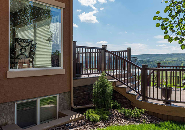 Aluminum railings provide a low maintenance deck seating area.